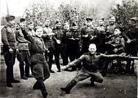 Фото. Герой Советского Союза С.А. Ахтямов (с гармонью) с однополчанами во время  празднования дня Победы. Май 1945